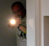 Using a flashlight in tandem with a handgun